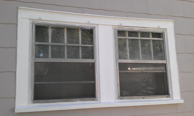 Photo gallery vinyl replacement windows roofing for Anderson vinyl windows